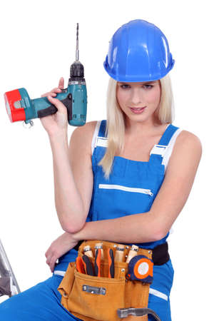 sexy craftswoman holding a drill photo