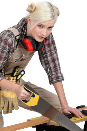 crosscut: Woman sawing a plank of wood