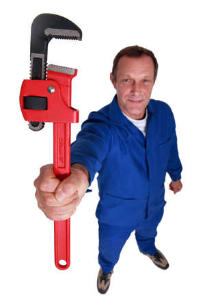 gripping hair: Manual worker with wrench Stock Photo