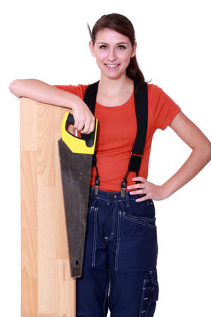 craftswoman: craftswoman holding a handsaw