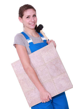 Woman with a floor tile and a mallet Stock Photo - 16951433