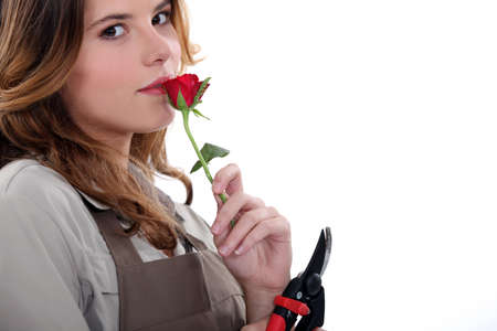 Woman smelling a rose photo