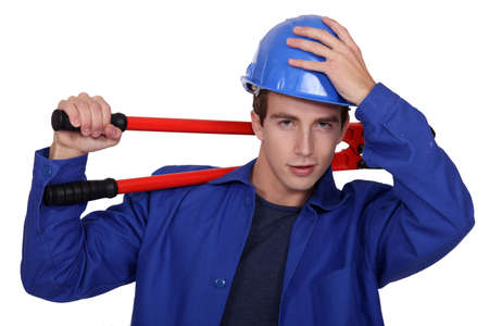 Manual worker posing with bolt cutters Stock Photo - 16951424