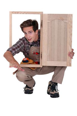 made to measure: Carpenter with cupboard door