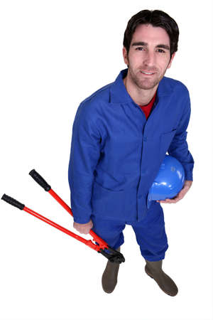 Worker wearing blue overalls photo