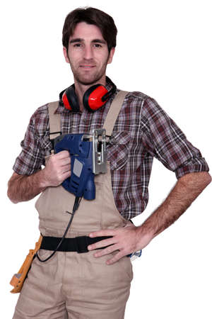 anti noise: Man with an electric saw Stock Photo