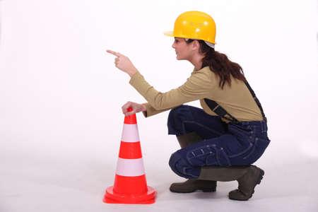 authoritative woman: Worker controlling traffic