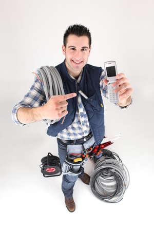 Tradesman with his mobile phone photo