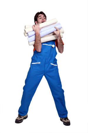 Man laden with rolls of wallpaper Stock Photo - 17219208
