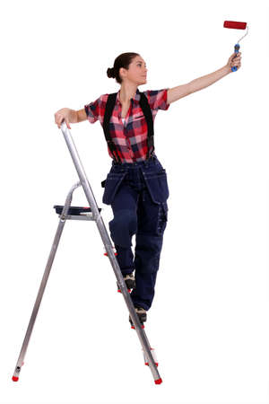 Painter standing on a stepladder photo