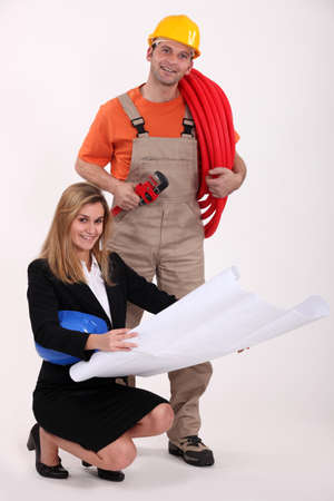 Plumber and designer discussing plans Stock Photo - 17219354