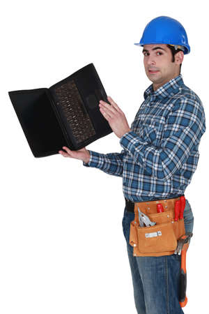 Carpenter stood with laptop photo
