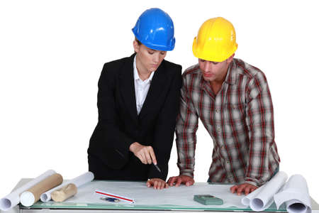 Two architects examining plans photo