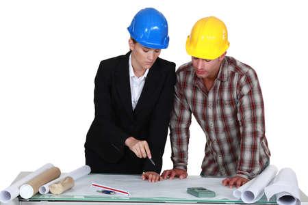 Two architects examining plans Stock Photo - 17219335