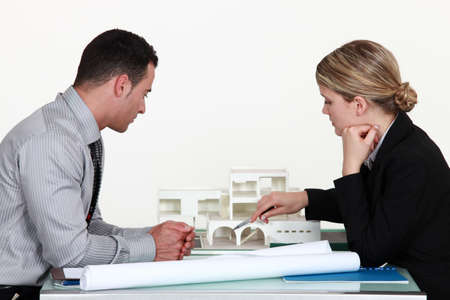 criticising: Architects evaluating a building model Stock Photo