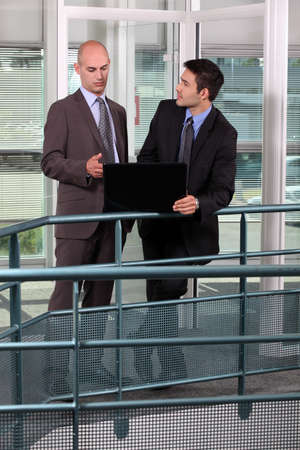 handrail: Associates discussing their business plan Stock Photo