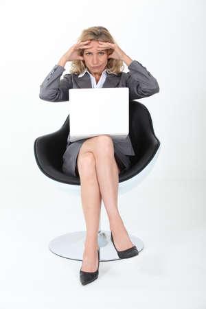 Businesswoman holding head photo