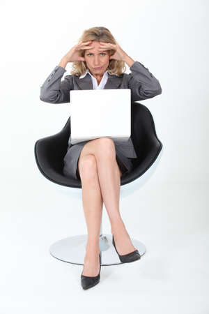 sales representative: Businesswoman holding head