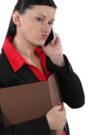 sceptic: Doubtful businesswoman talking on her mobile phone
