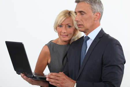 median age: Man and woman with computer