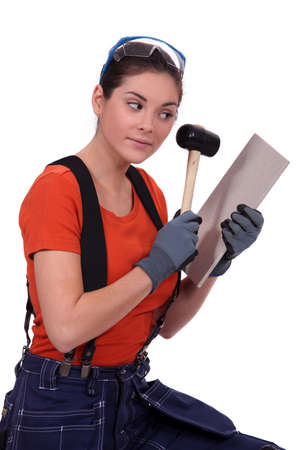 Woman worker with a hammer photo
