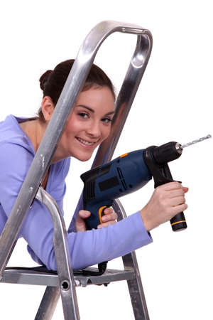 Woman with drill Stock Photo - 17214113