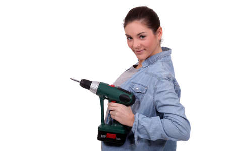 Woman holding an electric screwdriver photo