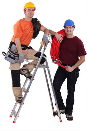 tradesmen: A team of tradesmen posing with their tools