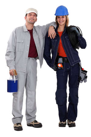 workwoman: Painter and electrician standing side by side