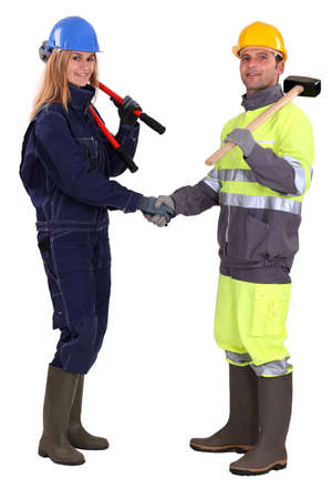 Tradespeople shaking hands photo