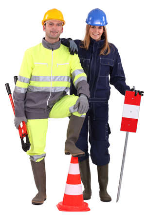 construction crew: Construction crew with tools and warning signs Stock Photo