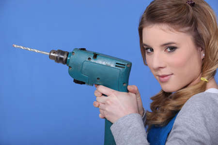 Woman holding power drill photo