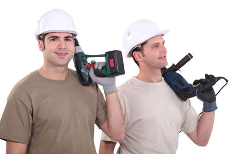 Two male builder with drills photo