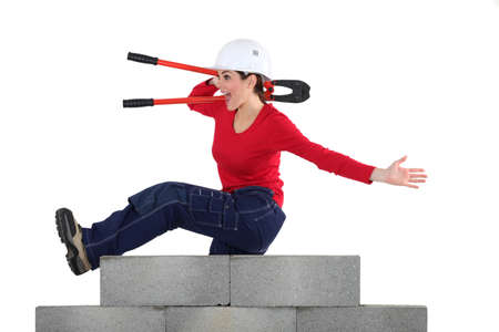 Woman with pincers jumping photo