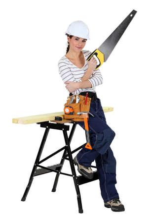 handywoman with a saw photo