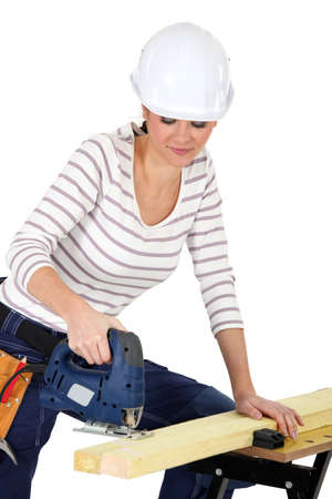 sander: attractive young female joiner using sander machine Stock Photo