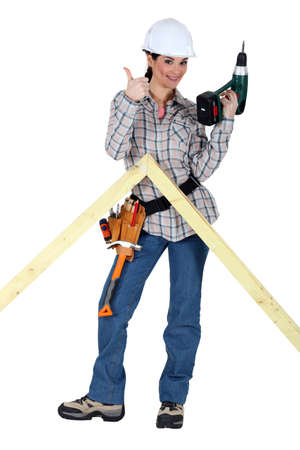 Woman making wooden truss Stock Photo - 17219880