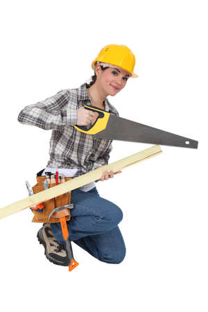 Woman with a saw and timber photo