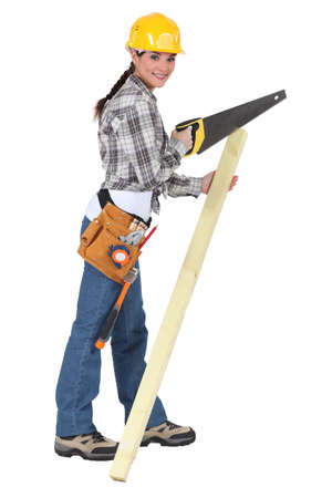 Woman with a saw and timber Stock Photo - 17219642