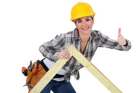 2x4 wood: Female carpenter with truss