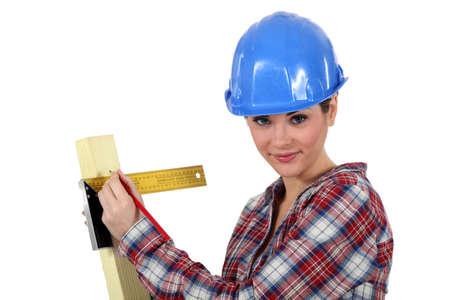 servicewoman: craftswoman taking measurements