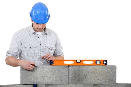erecting: bricklayer erecting concrete wall