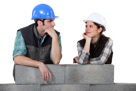 jobbing: Builders leaning on an unfinished wall