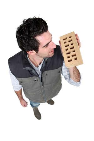 Builder holding brick Stock Photo - 17219866