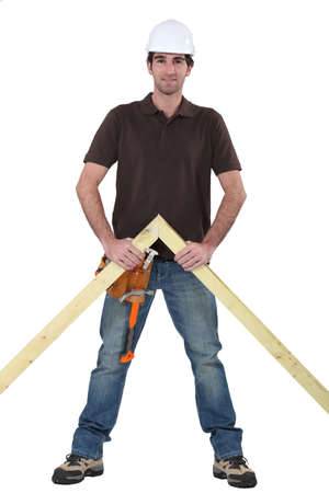 truss: Carpenter stood with wooden truss