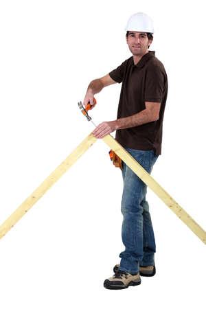 roof framing: Carpenter nailing an apex