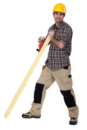 smoothen: Tradesman smoothing a plank of wood Stock Photo