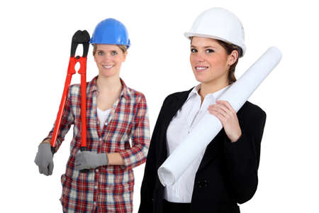 oversized: A tradeswoman and an engineer working together Stock Photo