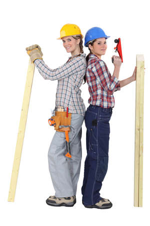 whittle: Two female carpenters Stock Photo