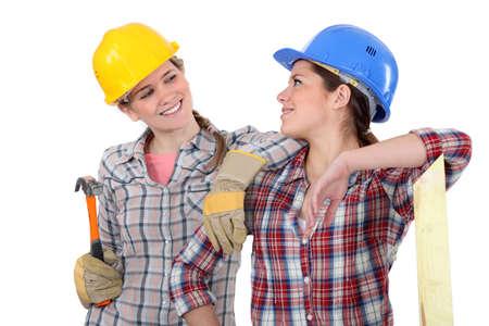 wife beater: Female carpenters Stock Photo